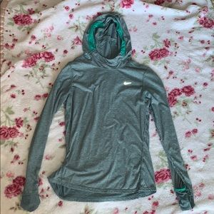 cute nike running top with thumb holes and pocket